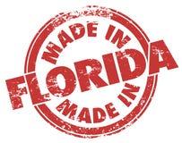 Hecho en servicio rojo del producto de FL del Grunge de la tinta del sello de la Florida ilustración del vector