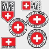 Hecho en sistema de etiqueta de Suiza con la bandera, suizo hecho, vector Foto de archivo libre de regalías