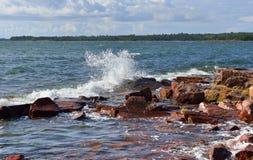 Hectic Baltic Sea. Splashes and foam. Rocky Baltic Sea. Aland, Finland Stock Photo