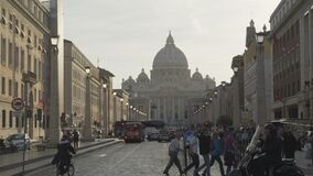 Hectic life in center of Rome, many tourists walking street to church in Vatican. Stock footage stock video footage