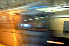 Hectic Life. Fast and hectic life represented by a subway train in movement as the background is still Royalty Free Stock Photos