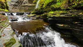 Hector Falls New York. Hector falls in New York surrounded by trees and plants with peak fall colors. A beautiful roadside waterfall just north of Watkins Glen stock video