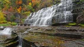 Hector Falls New York. Hector falls in New York surrounded by trees and plants with peak fall colors. A beautiful roadside waterfall just north of Watkins Glen stock video footage