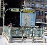 Hector Guimard Metra Entrance. This is a Winter picture of the iconic Van Buren Metra Train Entrance on a bed of snow, located on Michigan Avenue in Chicago Stock Image