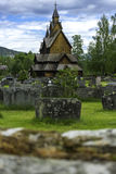 Heddal Church in Norway. A dimensional shot with a wall and beyond the stave church of Heddal Stock Photo