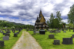 Heddal Stave Church in Norway. A horizantal shot of Heddal stave church with his cementary Royalty Free Stock Images
