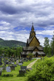 Heddal Stave Church. A shot of the stave church in Heddal with his cementary Royalty Free Stock Photography