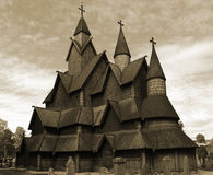 Heddal stavkyrkje. Traditional Norwegian wooden Stave Church (Imitation of an old photo royalty free stock photography
