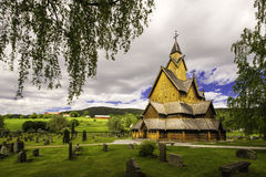 Heddal Yard and Stave Church. A view of the church in Heddal, his yard and cementary Stock Photography