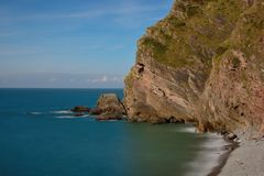 Heddons mouth in Devon. Long exposure of the beach at Heddons mouth in Devon royalty free stock images