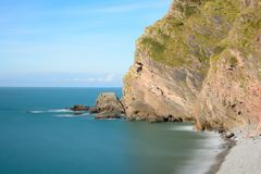 Heddons mouth in Devon. Long exposure of the beach at Heddons mouth in Devon royalty free stock photo