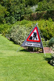 Hedge cutting sign in country garden Royalty Free Stock Photo