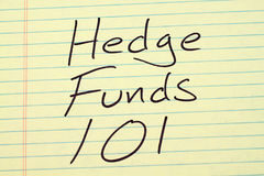 Hedge Funds 101 On A Yellow Legal Pad. The words `Hedge Funds 101` on a yellow legal pad Royalty Free Stock Photos