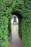 Hedge keyhole arch pathway gate Royalty Free Stock Photography