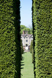Through the hedge at Packwood House Stock Images