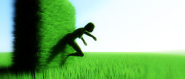 Hedge in shape of woman Royalty Free Stock Photography