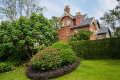 Hedged European-style houses in sunny autumn Stock Photo