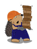 Hedgehog builder with bricks Stock Image