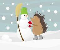 Hedgehog com um boneco de neve Fotografia de Stock Royalty Free