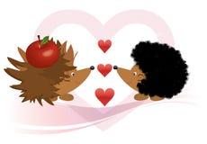 Hedgehog e uma maçã Fotografia de Stock Royalty Free
