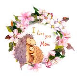 Hedgehog hugging her baby in floral wreath. Card for Mothers day with text I love you Mom . Watercolor Royalty Free Stock Photos