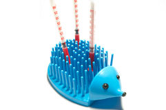 Hedgehog with insulin-syringe Stock Photos