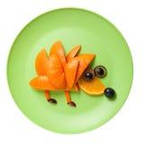 Hedgehog made of orange and grape Stock Photos