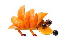 Hedgehog made of orange and grape Royalty Free Stock Image