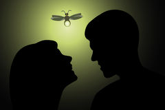 Hedgehog in the metropolis. Girl and guy kissing by the light of a butterfly Royalty Free Stock Images