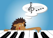 Hedgehog and a piano Royalty Free Stock Image