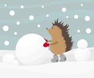 Hedgehog que cria um boneco de neve Imagens de Stock