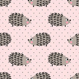 Hedgehog seamless pattern on pink polka dots background. Cute cartoon animal background. Child drawing style baby hedgehog illustration. Kids design for fabric Stock Photos