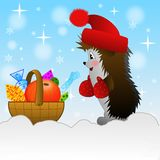 Hedgehog and small basket with gifts  on to snow Royalty Free Stock Photos
