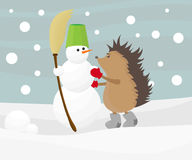 Hedgehog with a snowman Royalty Free Stock Photography