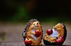Hedgehogs with apples figurines
