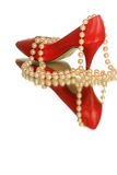 Heel with pearls. Red high heel reflected on mirror Stock Photos
