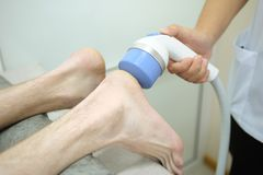 Heel procedure. With special equipment royalty free stock photo