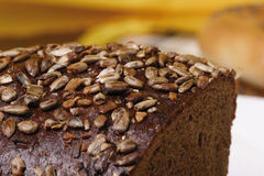 Heel of rye bread. With sunflower seed stock photos