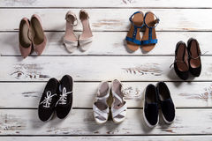 Heel shoes and casual keds. Royalty Free Stock Image