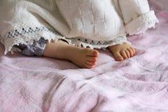 Heel sleeping baby girl Stock Photo