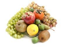 Heel wat rijp fruit op een glasplaat Royalty-vrije Stock Foto's