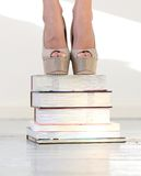 Heels on books Royalty Free Stock Photography