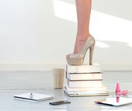 Heels on books. Books. Beautiful shoes on heels Stock Photography