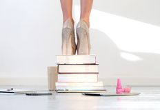 Heels on books. Books. Beautiful shoes on heels Stock Photos