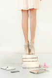 Heels on books. Books. Beautiful shoes on heels Royalty Free Stock Image