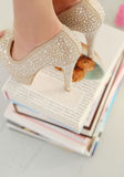 Heels on books Royalty Free Stock Images