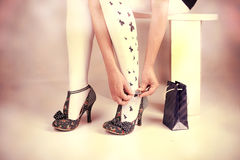 Heels. Legs in heels, Woman legs wearing gift and heels Stock Image