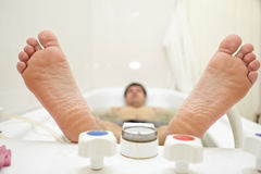 Heels lying person in the bath Royalty Free Stock Image