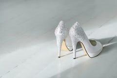 Heels. White heels on the floor Stock Images