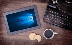 HEERENVEEN, NETHERLANDS, June 6, 2015: Tablet computer with Windows 10. Background. Windows 10 is the new version of Windows OS by Microsoft Corporation; it Royalty Free Stock Photos